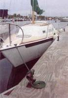 Boat dock lines, boat dock lines with boat moored to dock